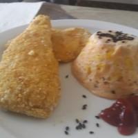 milanesitas de pollo con budin de choclo